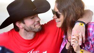 Ashton Kutcher und Mila Kunis lachen sich an