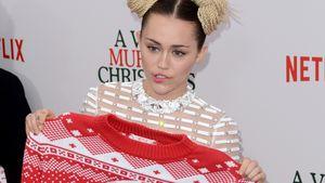 Miley Cyrus mit Weihnachtspulli