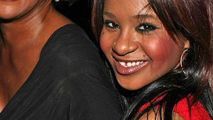 Whitney Houston und Tochter Bobbi Kristina lächeln