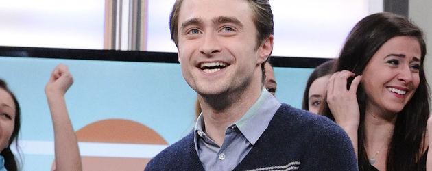 Daniel Radcliffe in Spießer-Look mir zurückgegelten Haaren Portrait