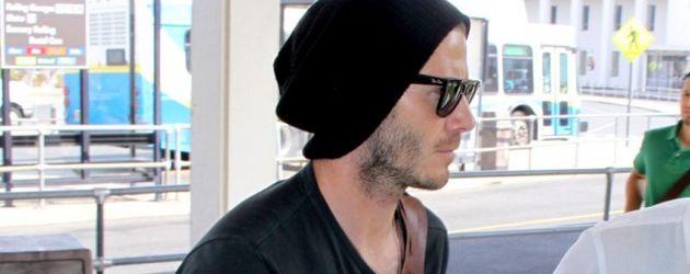 David Beckham mit Mütze und Sonnenbrille
