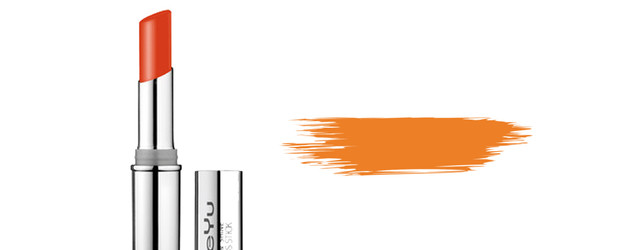Oranger Lippenstift und Farbkleks