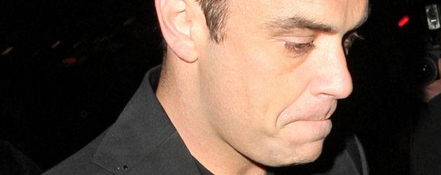 Robbie Williams sieht zerknirscht aus