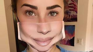 Schräg? Demi Lovato trägt Maske mit eigenem Lächeln darauf