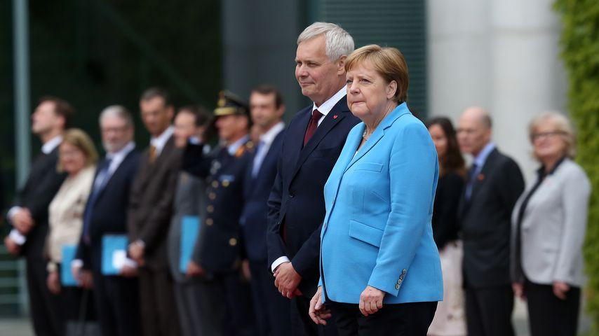 Antti Rinne und Angela Merkel