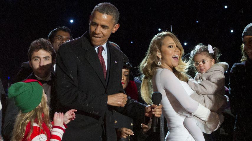 Barack Obama, Mariah Carey und Michelle Obama im Dezember 2013