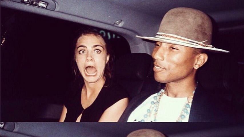 Cara Delevingne und Pharrell Williams