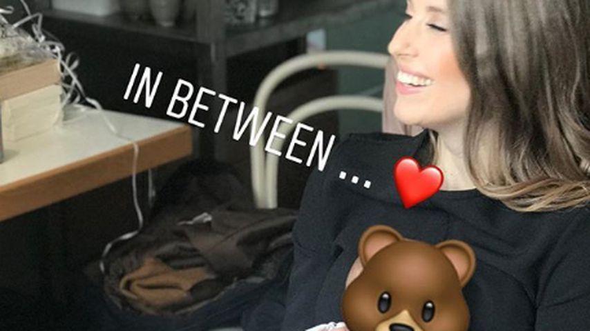 Cathy Hummels mit Baby Ludwig bei einem Fotoshooting