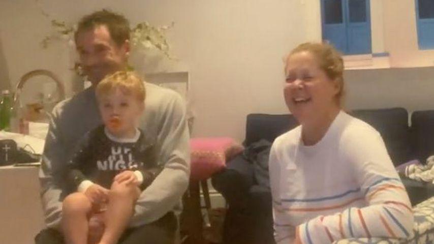 Chris Fischer mit seinem Sohn Gene und Amy Schumer