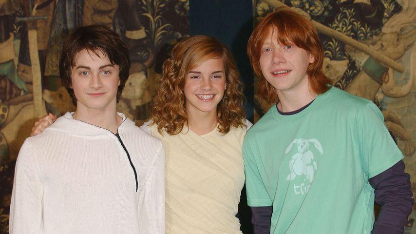 """Daniel Radcliffe, Emma Watson und Rupert Grint bei einem """"Harry Potter""""-Pressetermin, 2004"""