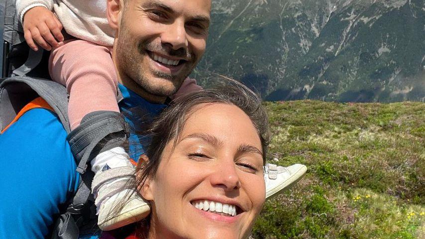 Fabian Nickel und Ziania Rubi mit ihrer Tochter in den Bergen