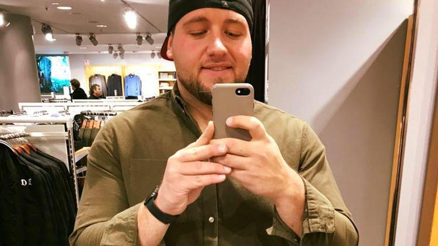 Giulio Arancio in einem Modegeschäft
