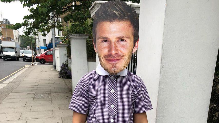 Harper Beckham mit David Beckham Maske