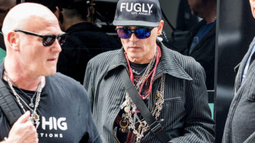 Johnny Depp bei Ankunft am Hotel Regent in Berlin
