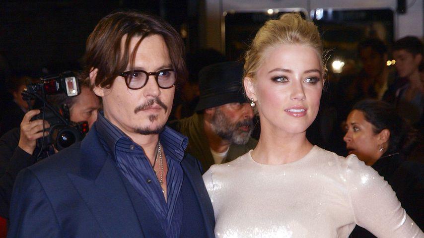 """Johnny Depp und Amber Heard bei der Premiere von """"The Rum Diary"""", 2011"""