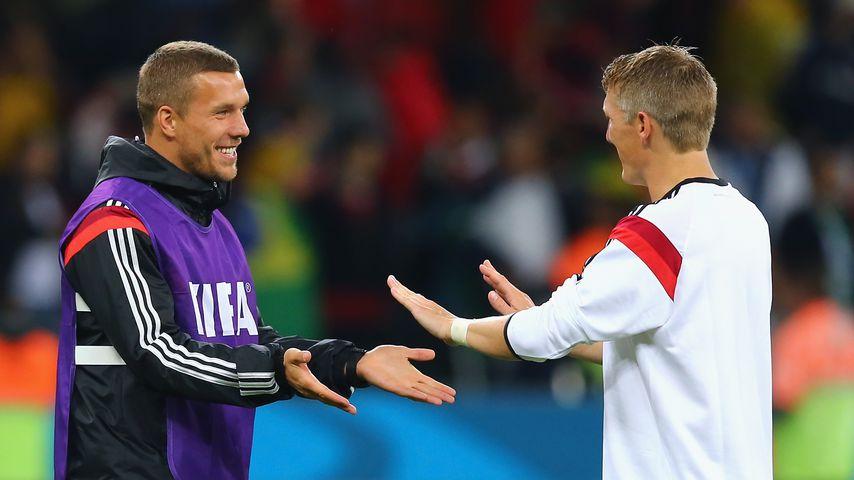Lukas Podolski und Bastian Schweinsteiger 2014 in Brasilien