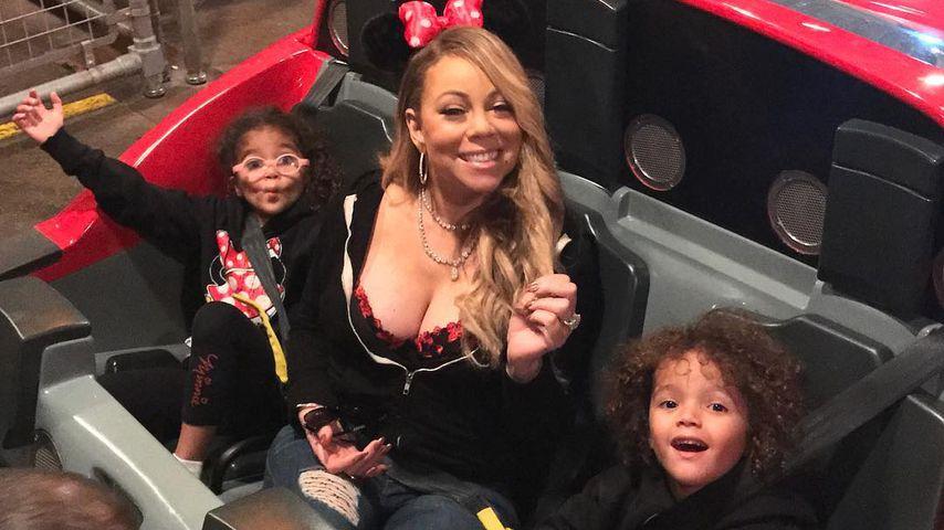Mariah Carey mit Monroe (l.) und Moroccan im Disneyland/ California