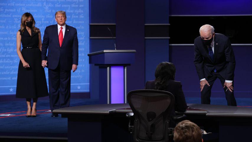 Melanie und Donald Trump und Joe Biden im Oktober 2020