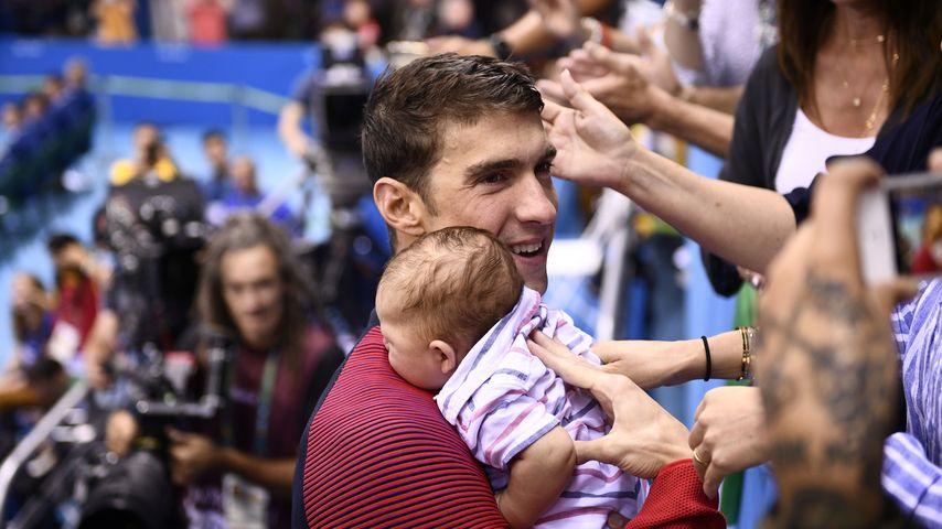 US-amerikanischer Schwimmer Michael Phelps mit seinem Sohn Boomer