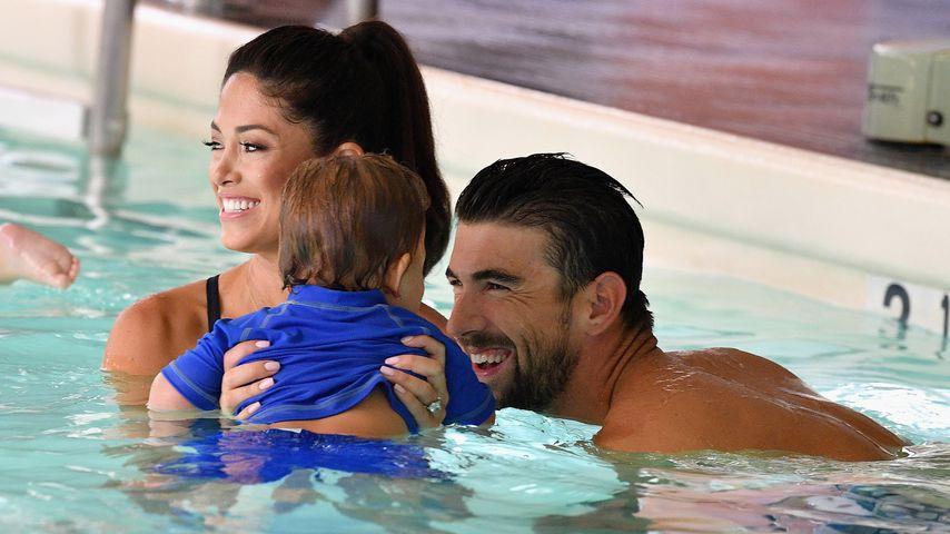 Nicole und Michael Phelps mit ihrem Sohn Boomer, 2017