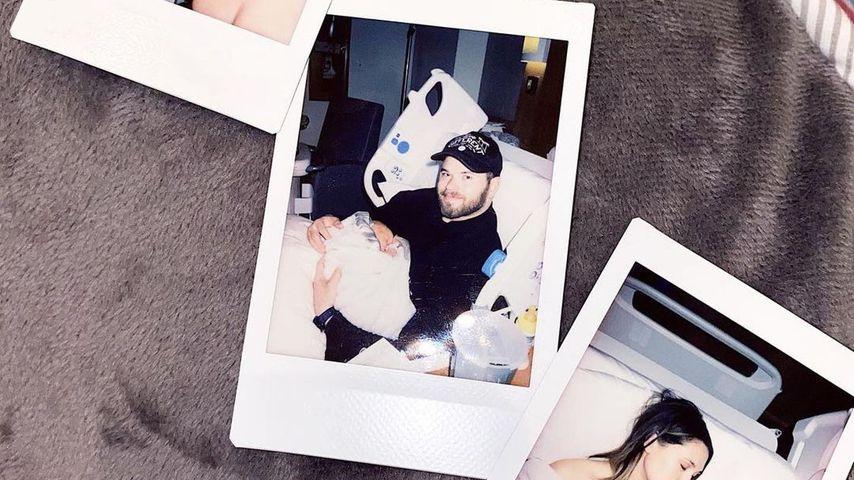 Kellan und Brittany Lynn Lutz mit ihrem Baby