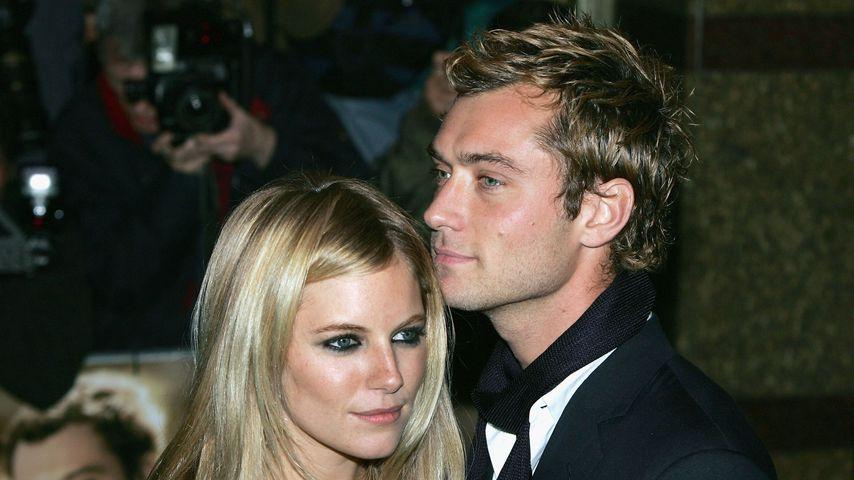Sienna Miller und Jude Law in London, 2004