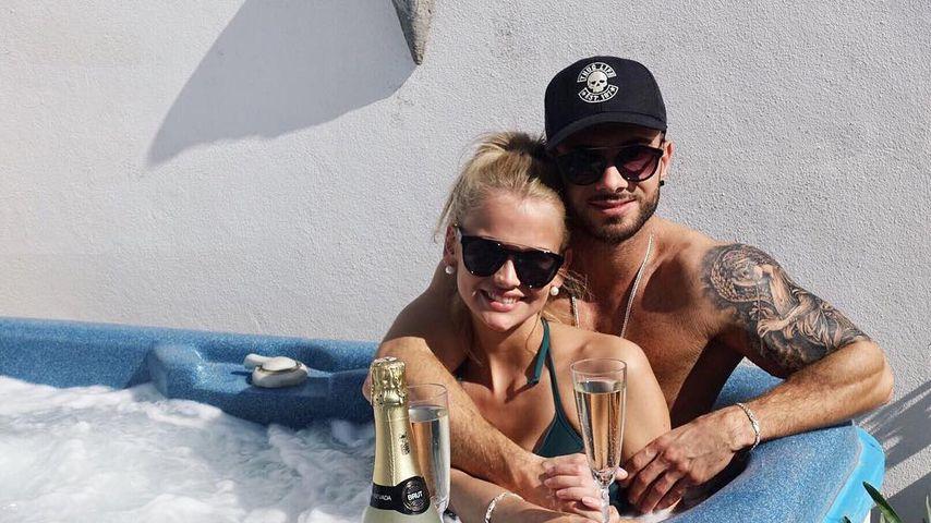 Stephanie Schmitz und Julian Evangelos um Urlaub