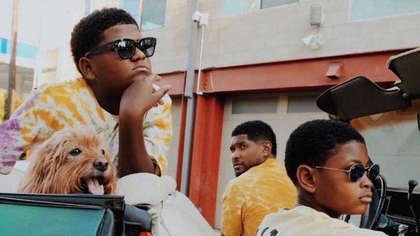 Usher mit seinen Söhnen Naviyd Ely Ramond und Usher Raymond V
