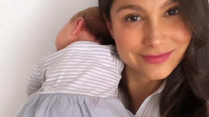 Ziania Rubi mit ihrer Tochter im Arm