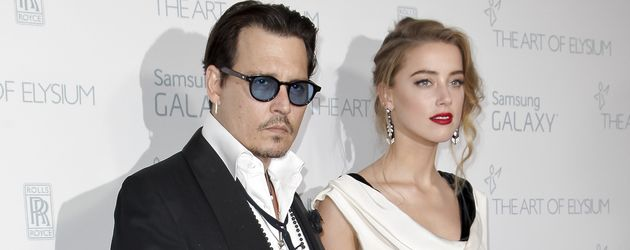Johnny Depp und Amber Heard auf dem Red Carpet