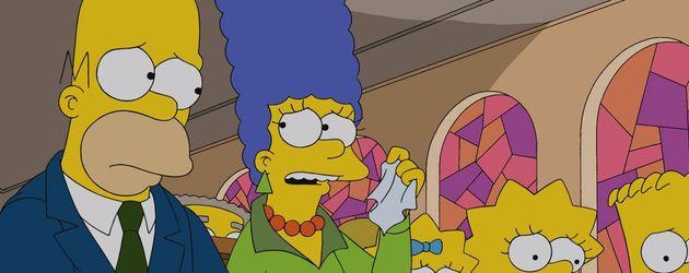 Homer und Marge Simpson in der Kirche