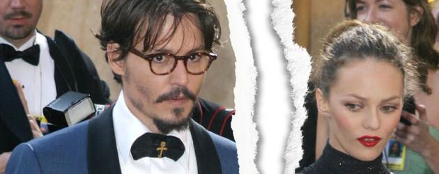 Johnny Depp und Vanessa Paradis gucken beide ernst und unglücklich