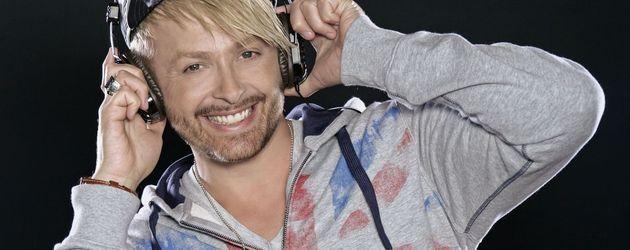 Ross Antony mit Kopfhörern